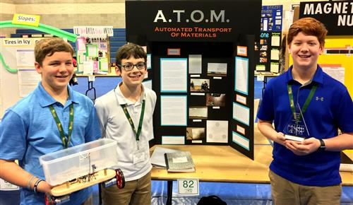 3 middle school students with project