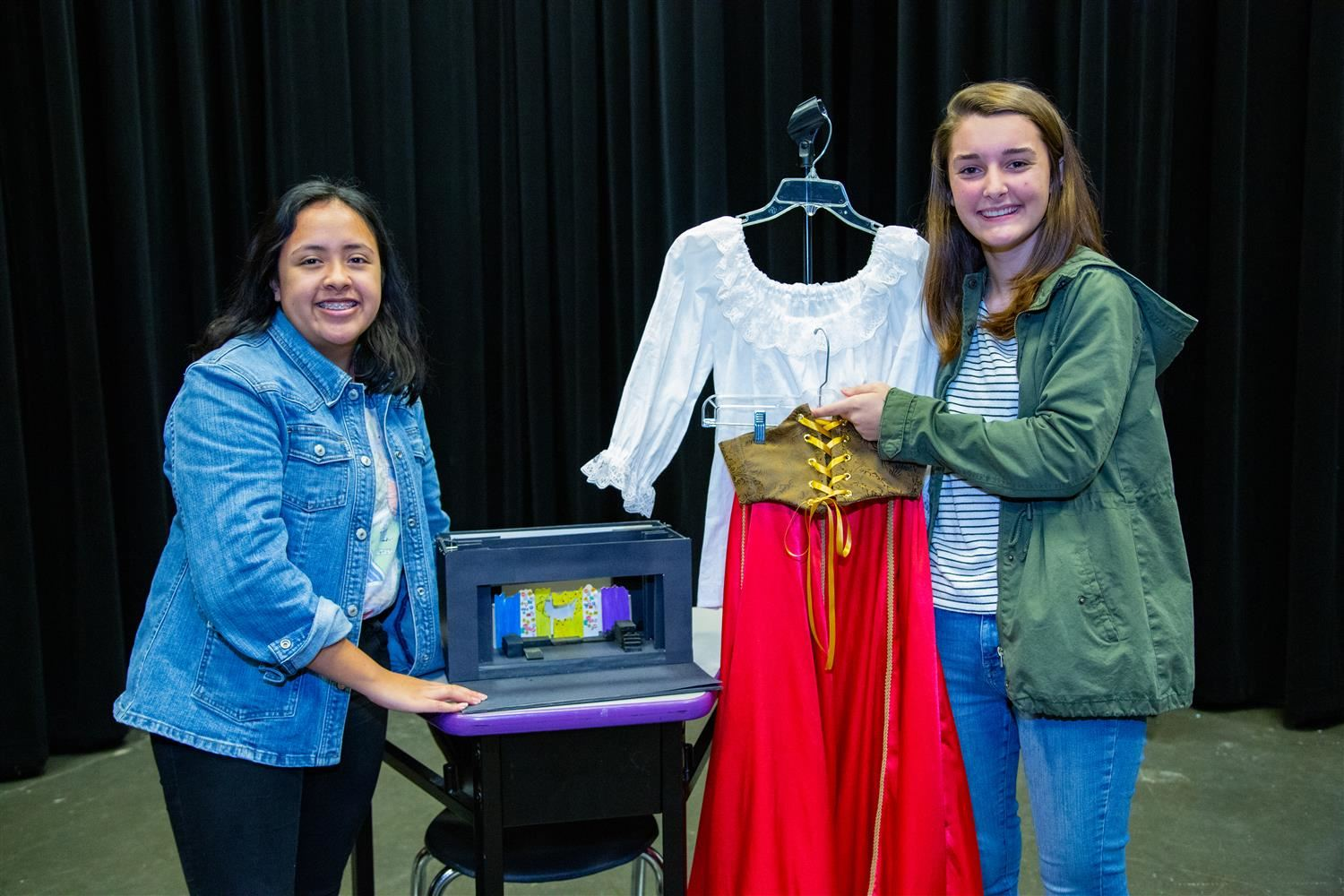 Leslie Cazares and Cassady Copas with their set and costume designe