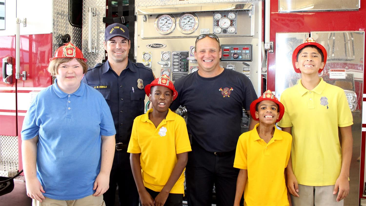 Firefighters with students