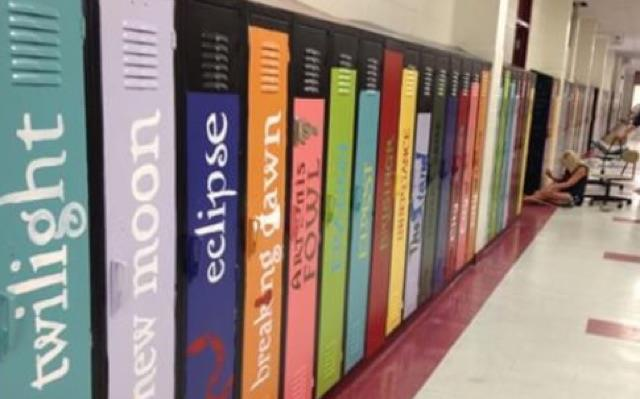Lockers have been painted to look like books on a library shelf.